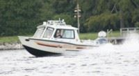 Marine Rescue Unit Boat Speeds Across the Waters Surface